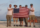 US team members with flag